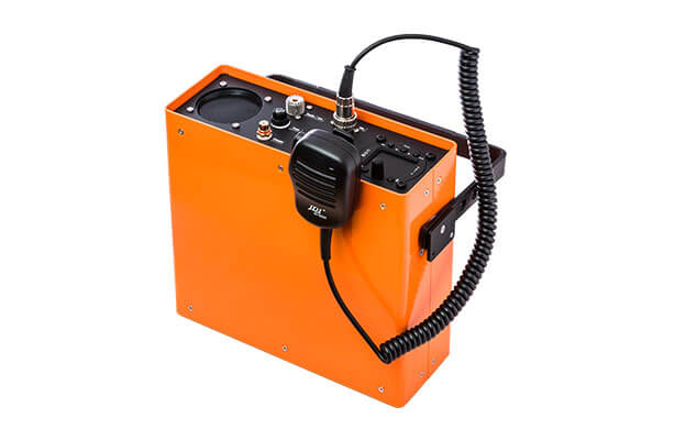 Portable radio station with radio, microphone, speaker and antenna